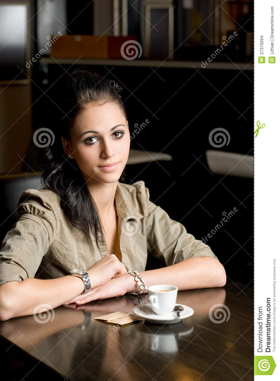 Lonely Boutique In Newmarket Auckland By Rufus Knight: Lonely Brunette In A Coffee Shop. Stock Images
