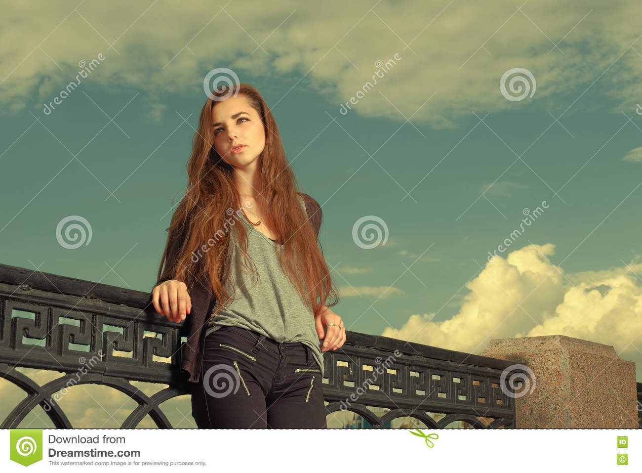 Download Lonely Girl Waits Someone To Talk. Wearing Light Gray Sweater, Black Pants, An Youg American Woman Standing By Metal Stock Image - Image of long, beautiful: 70829787