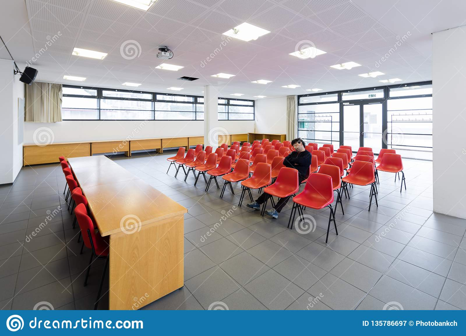 Lonely man in empty conference room, concept