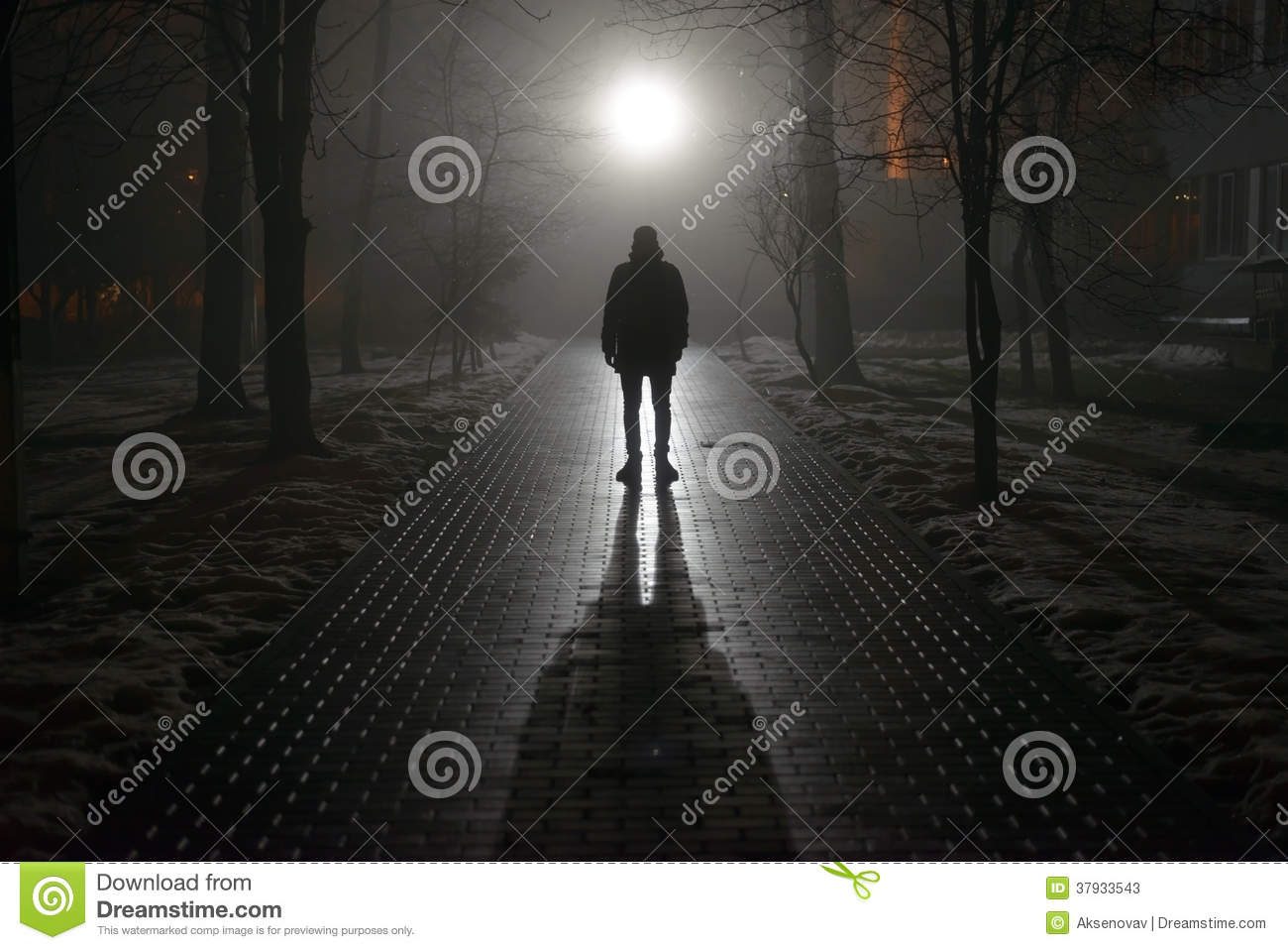 Lonely man in the fog at night