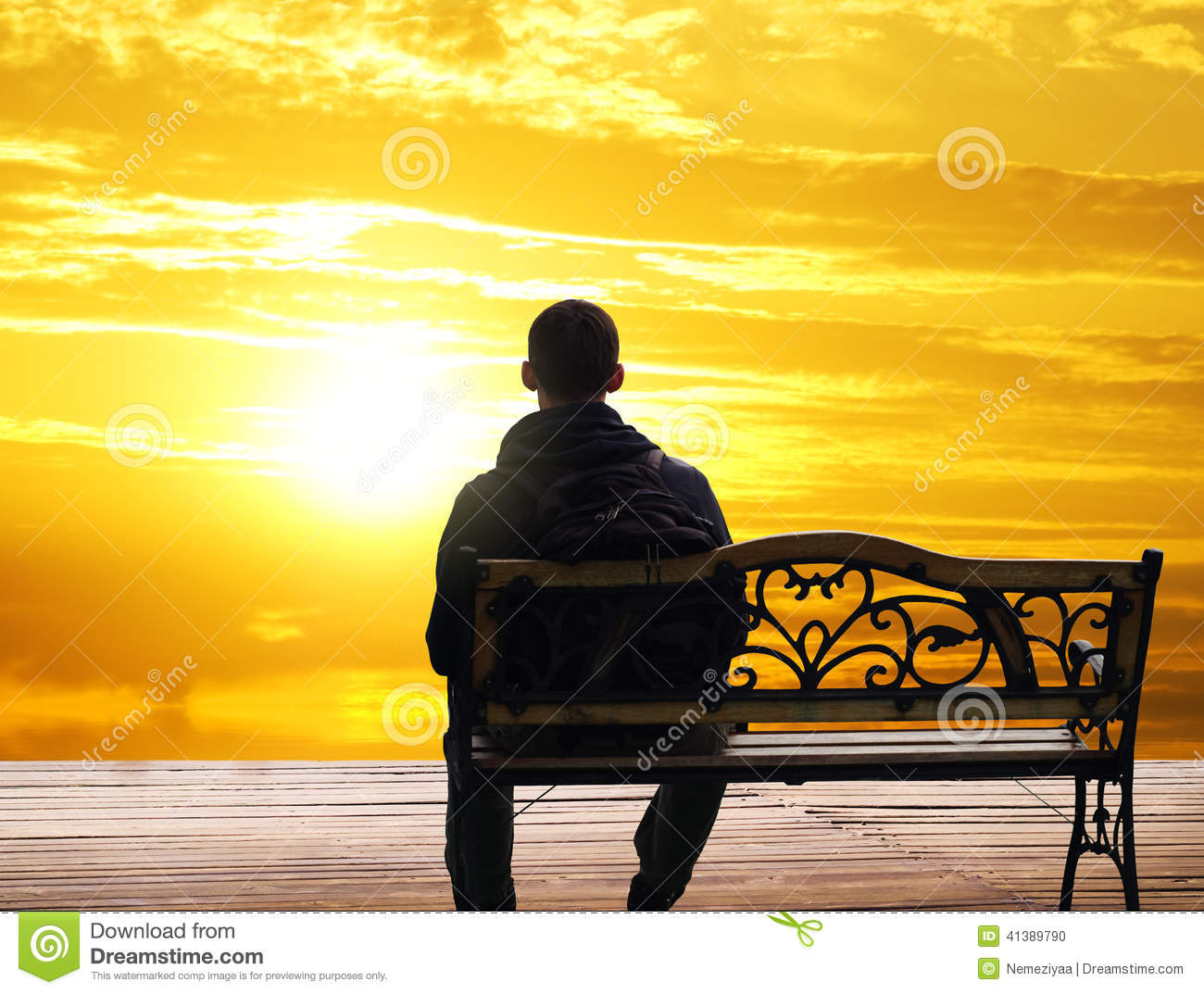 The Lonely Man Sits On A Decline Stock Photo