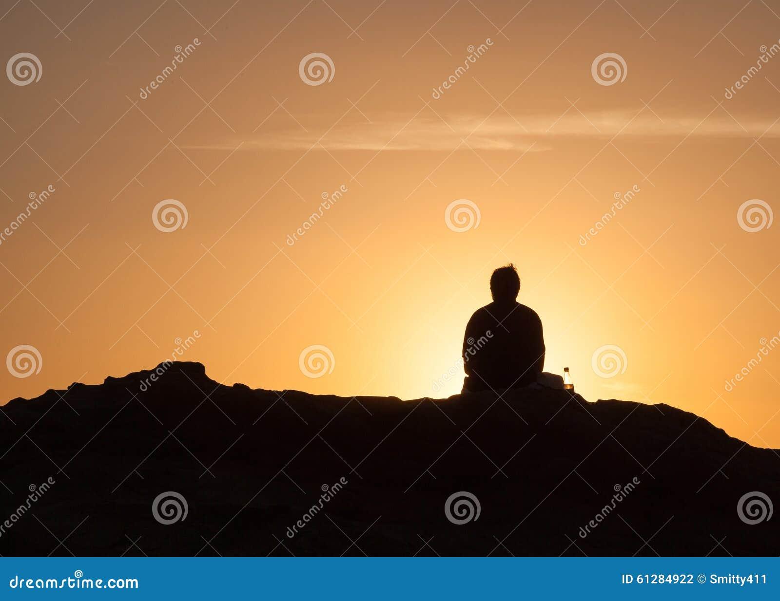 Lonely man at sunset in Laguna Beach