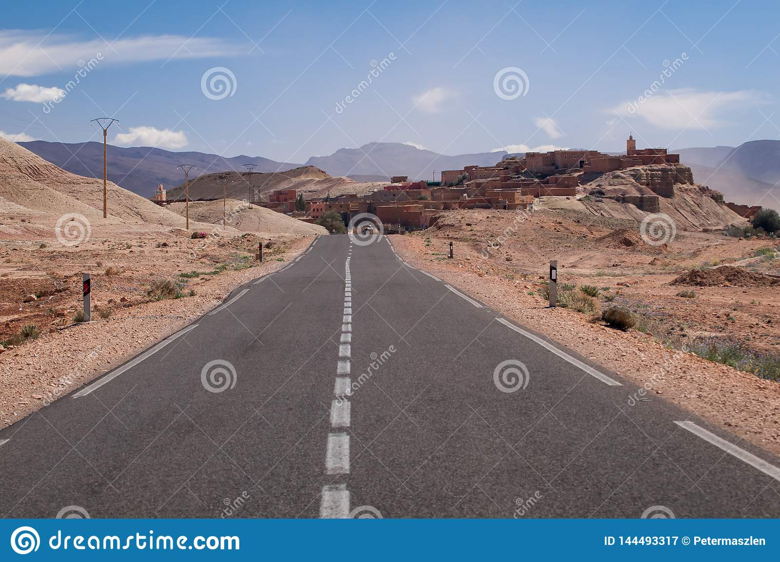 Lonely road to a small village in the desert of Morocco