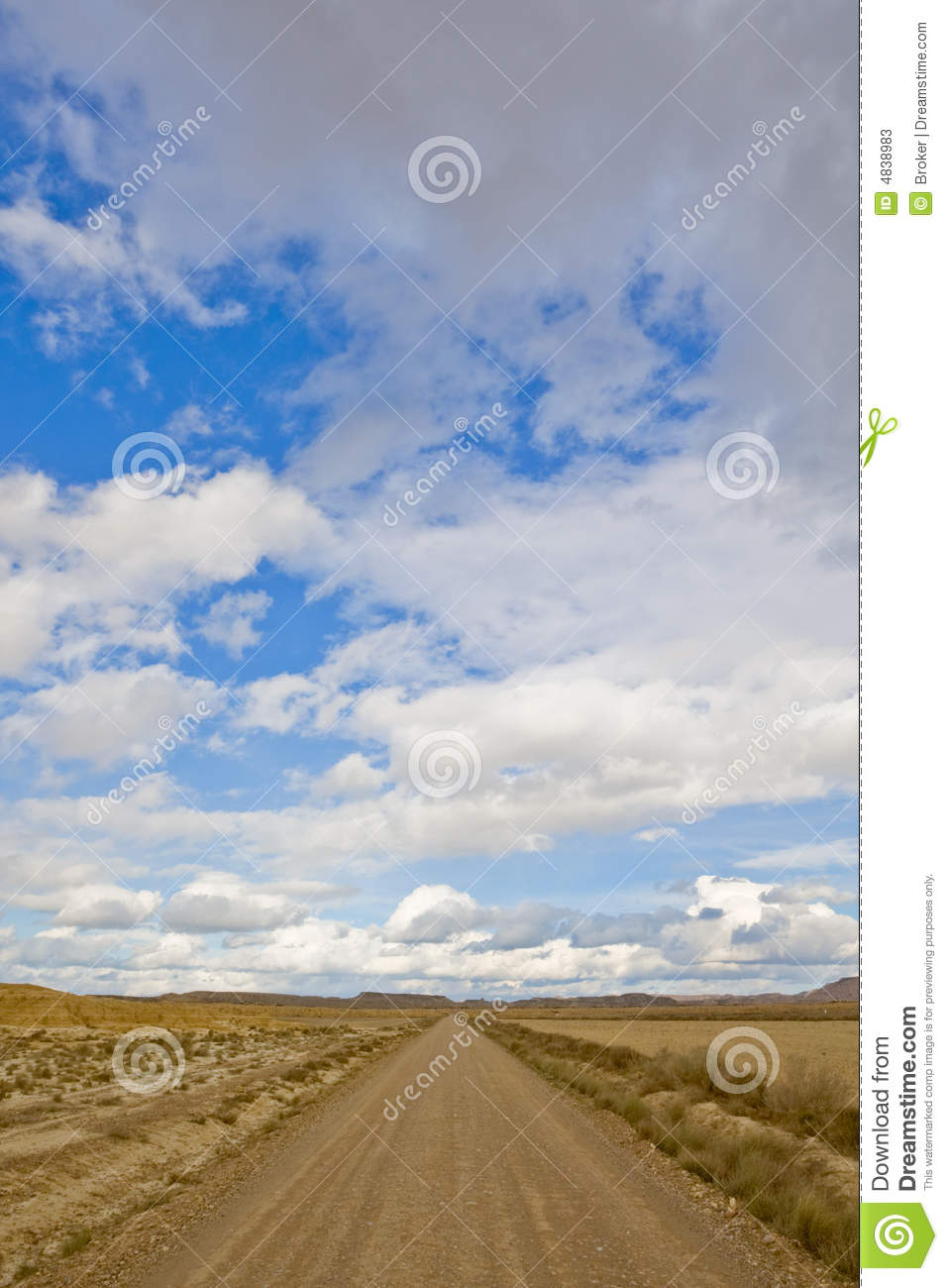 Lonely road under cloudy sky