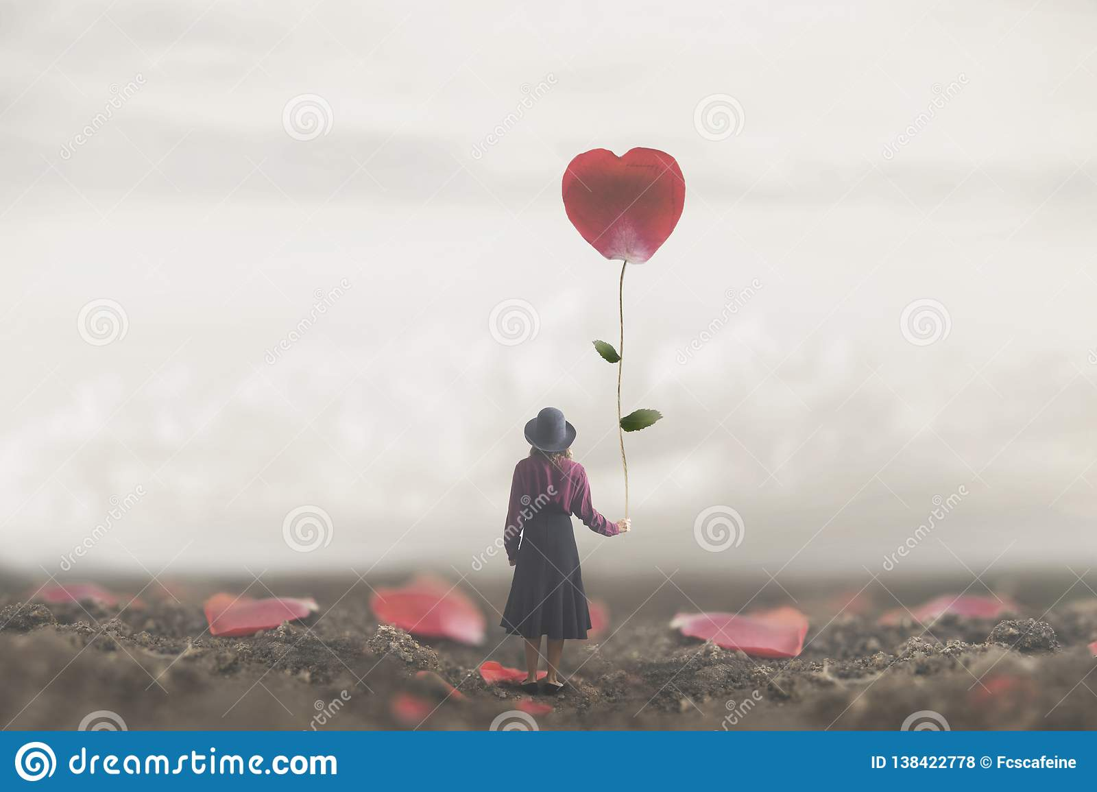 Lonely romantic woman holds a giant petal made to heart