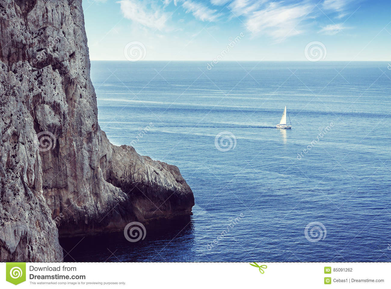 Lonely sailboat sailing on the sea