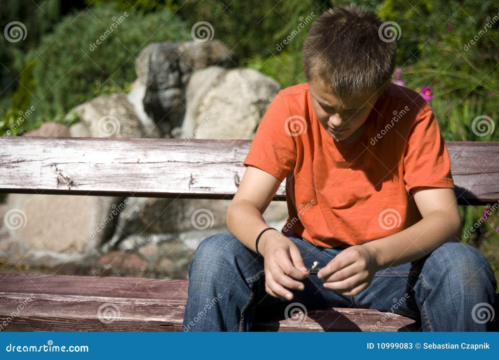 Lonely teenage boy