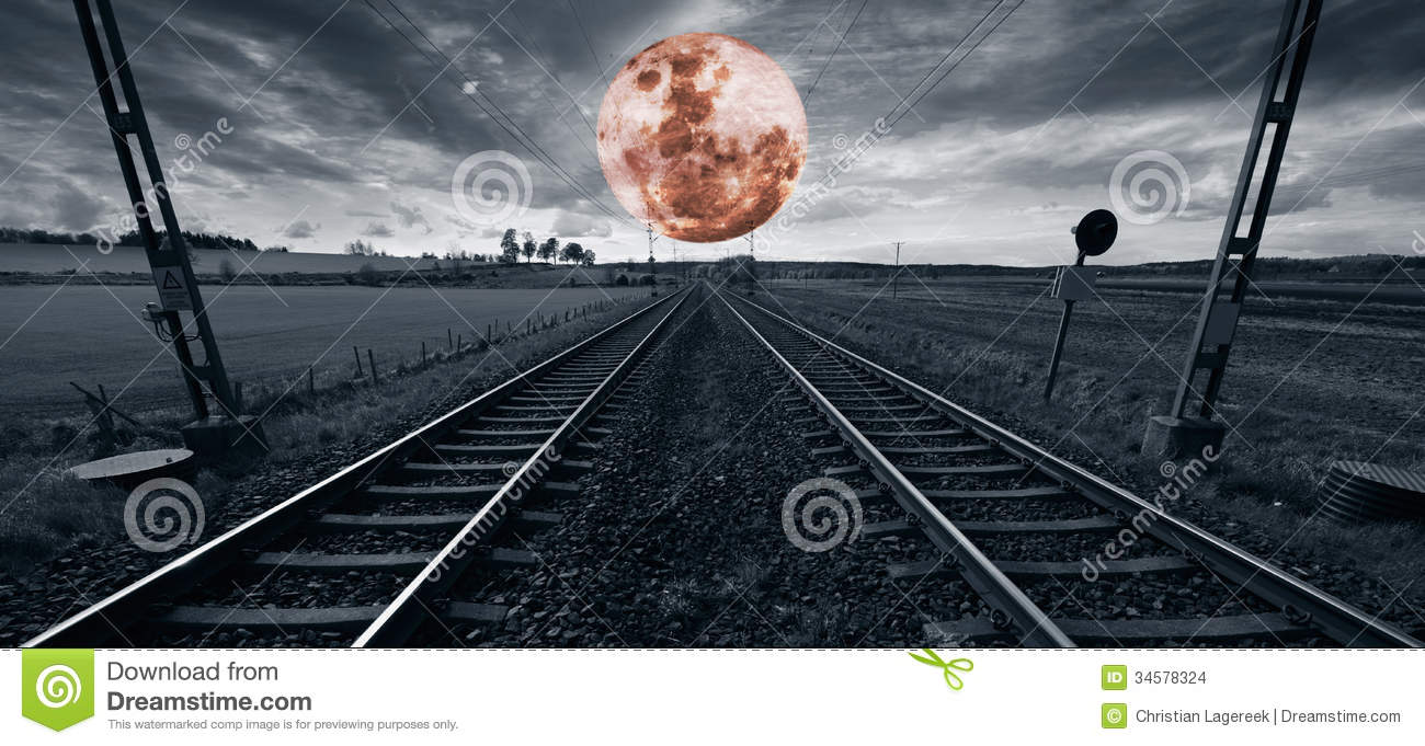 Lonely train track and a surreal full moon