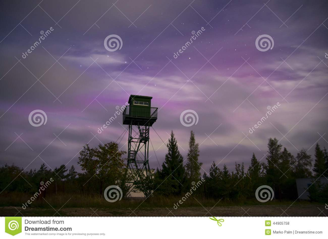 Lonely watch tower with Big Dipper and Aurora