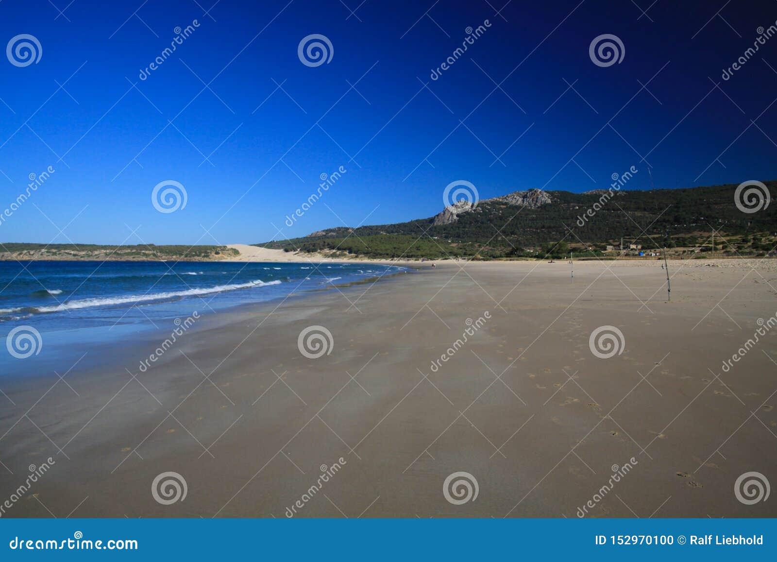 Lonely wide beach in the morning during low tide - Zahara delos Atunes at Costa de la Luz, Spain