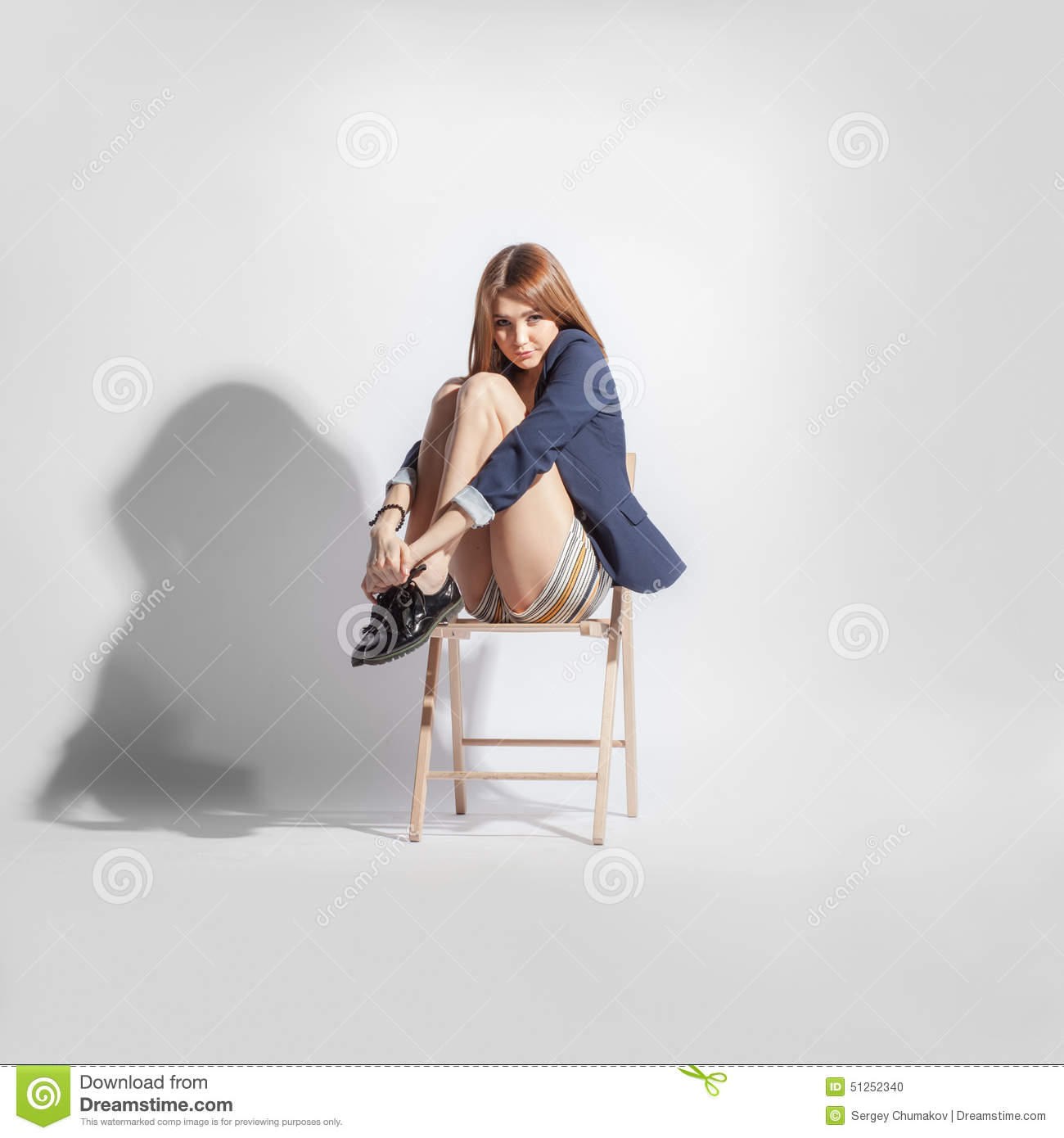 Lonely Woman On A Chair In Emryo Pose Stock Photo - Image of