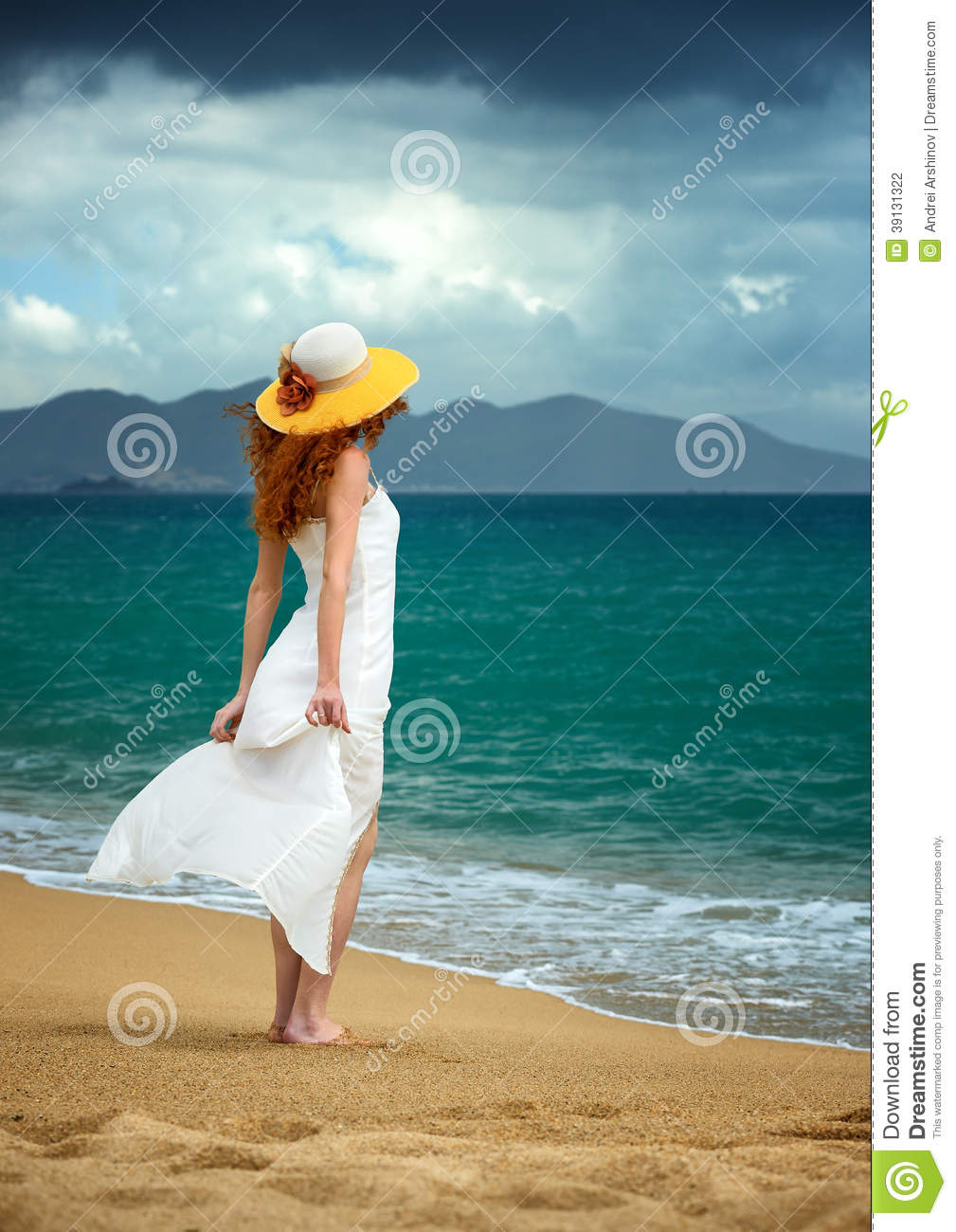 White dress by the shore - Lonely Woman In A White Dress Standing At The Sea Stock Photo
