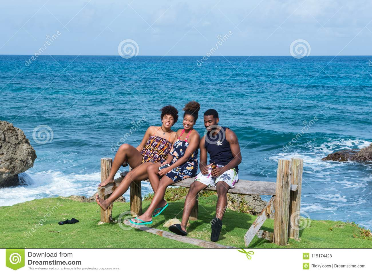 Long Bay, Portland, Jamaica - November 22, 2017: A group of American millennials enjoying themselves at the coastline at Long Bay,