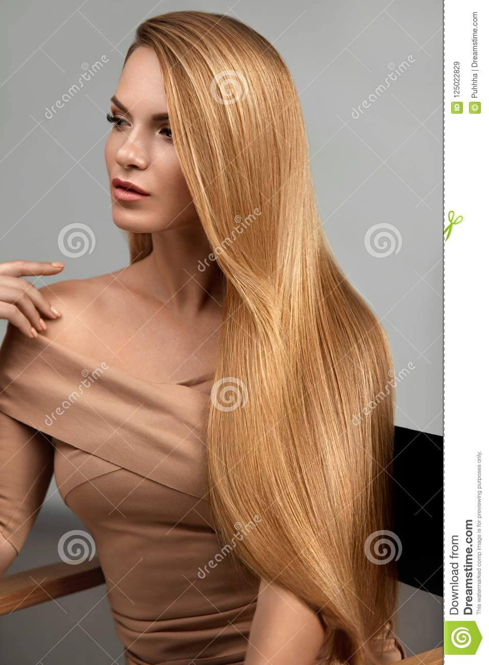 Long Blonde Hair. Beautiful Woman With Healthy Straight Hair