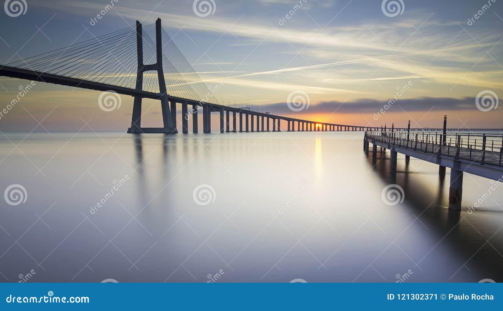 Long bridge over tagus river in Lisbon at sunrise