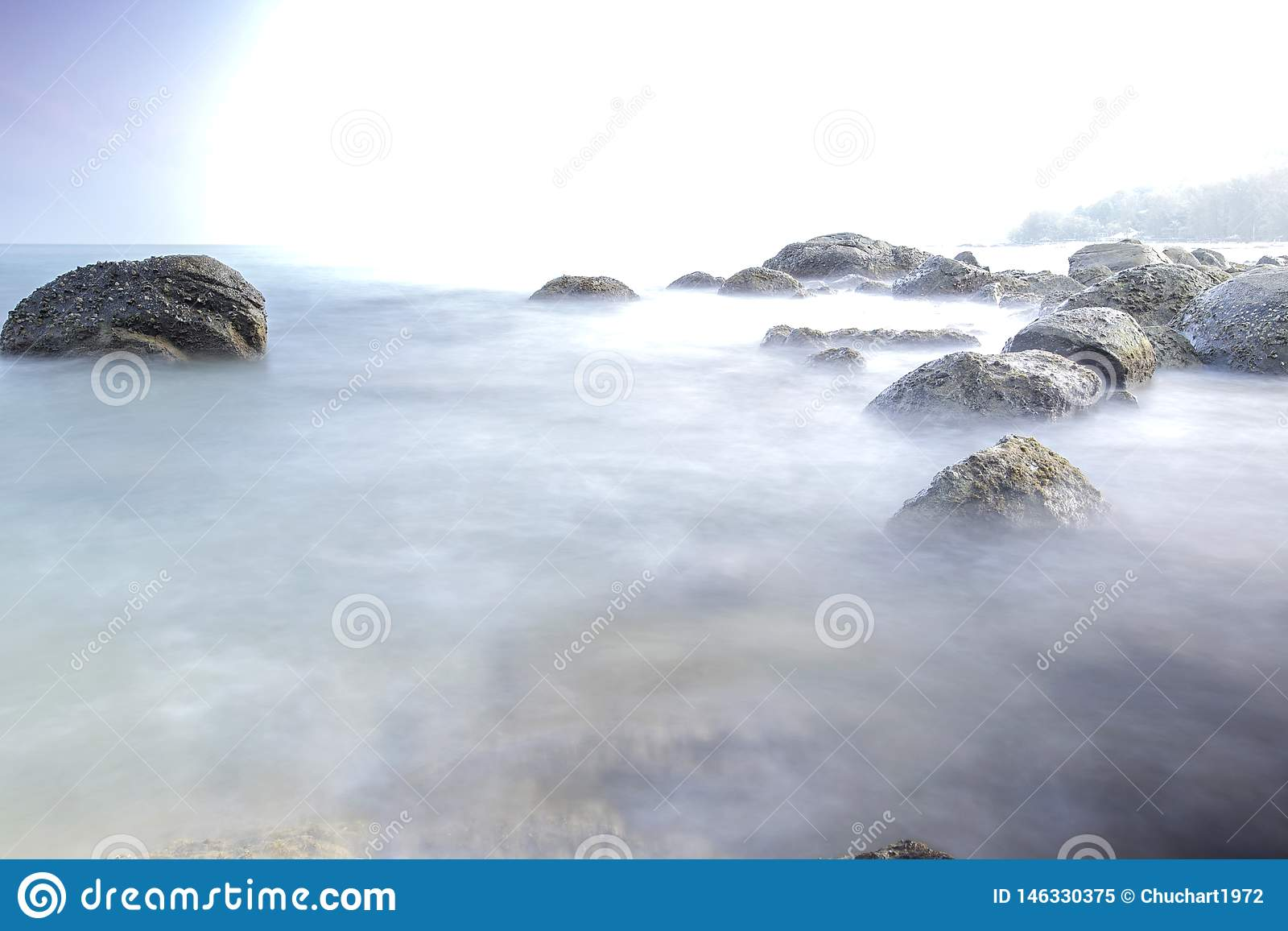 Long exposure image on stone and sunset landscape fo andaman sea