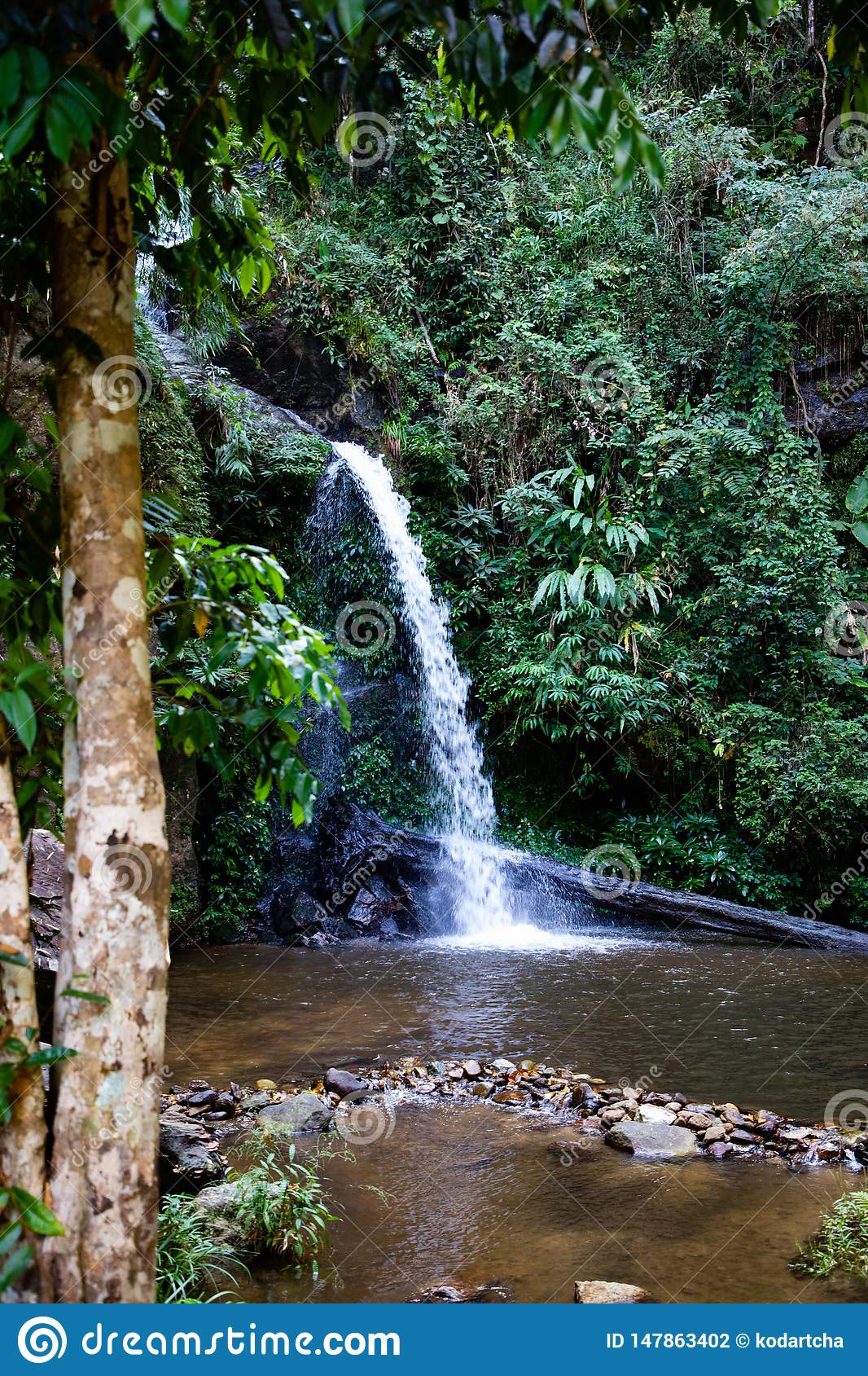 Long exposure of Montathan waterfall in the jungle of Chiang Mai Thailand