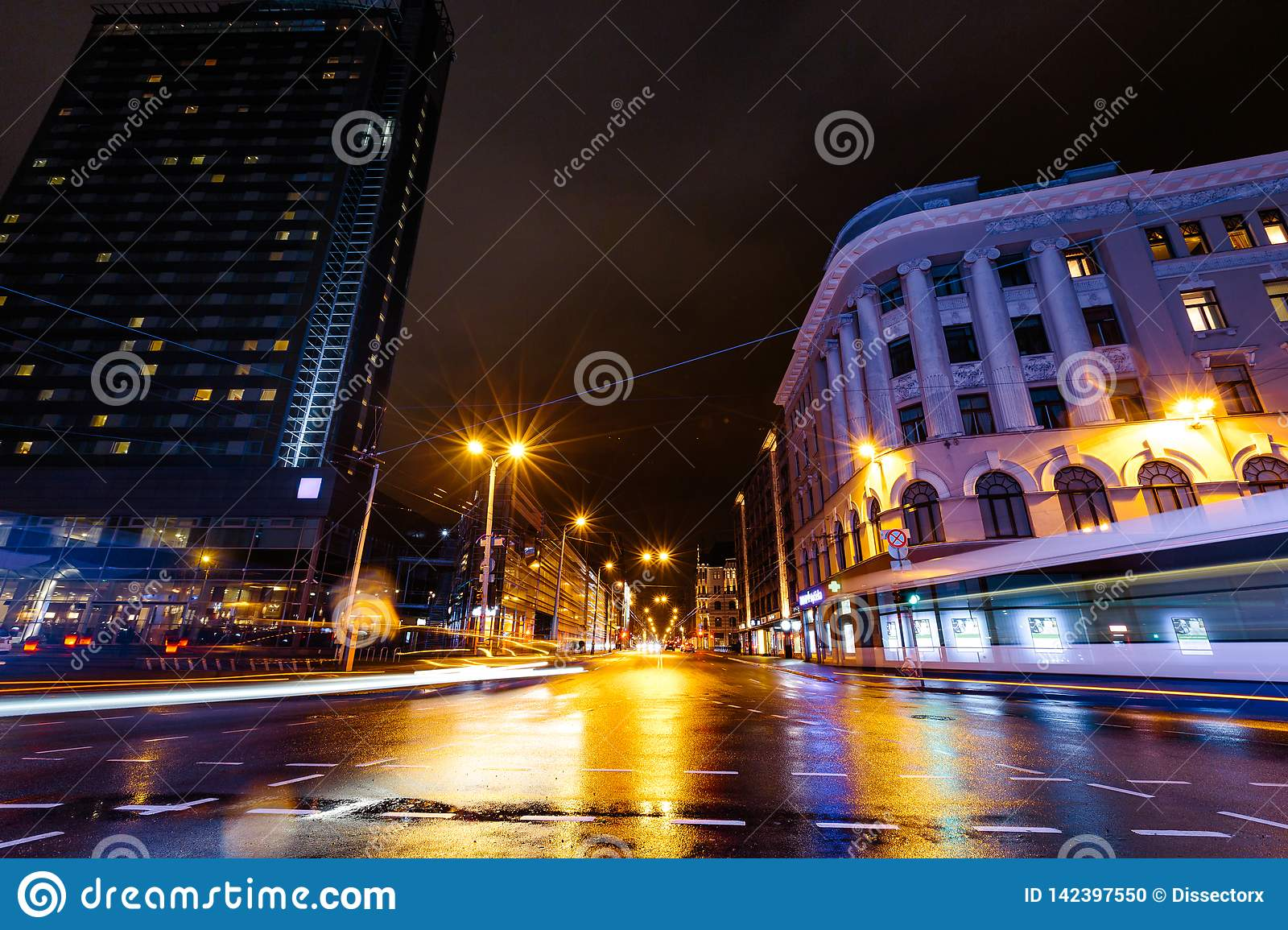 Long exposure of Riga main street Brivibas at night during rain in Latvia - Professional and best quality - Wet