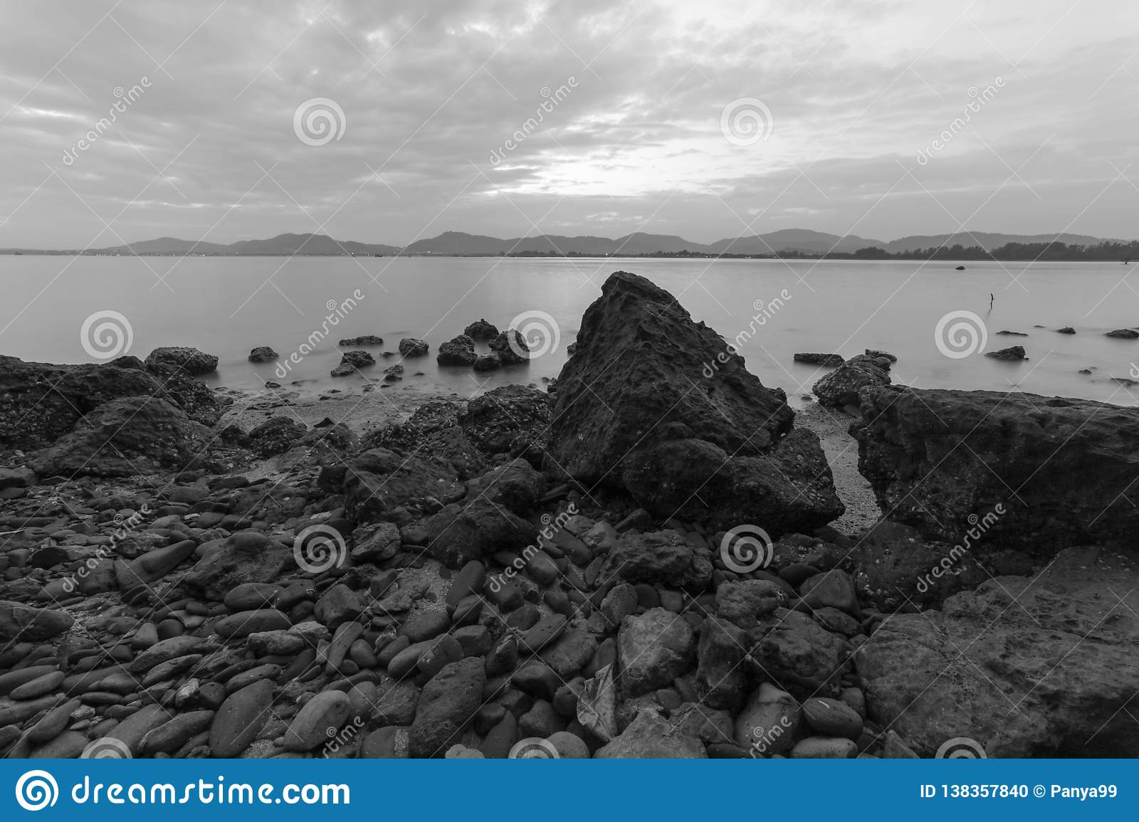 Long exposure of seascape scenery with rocks in black and white,beautiful image can be used nature composition for background and