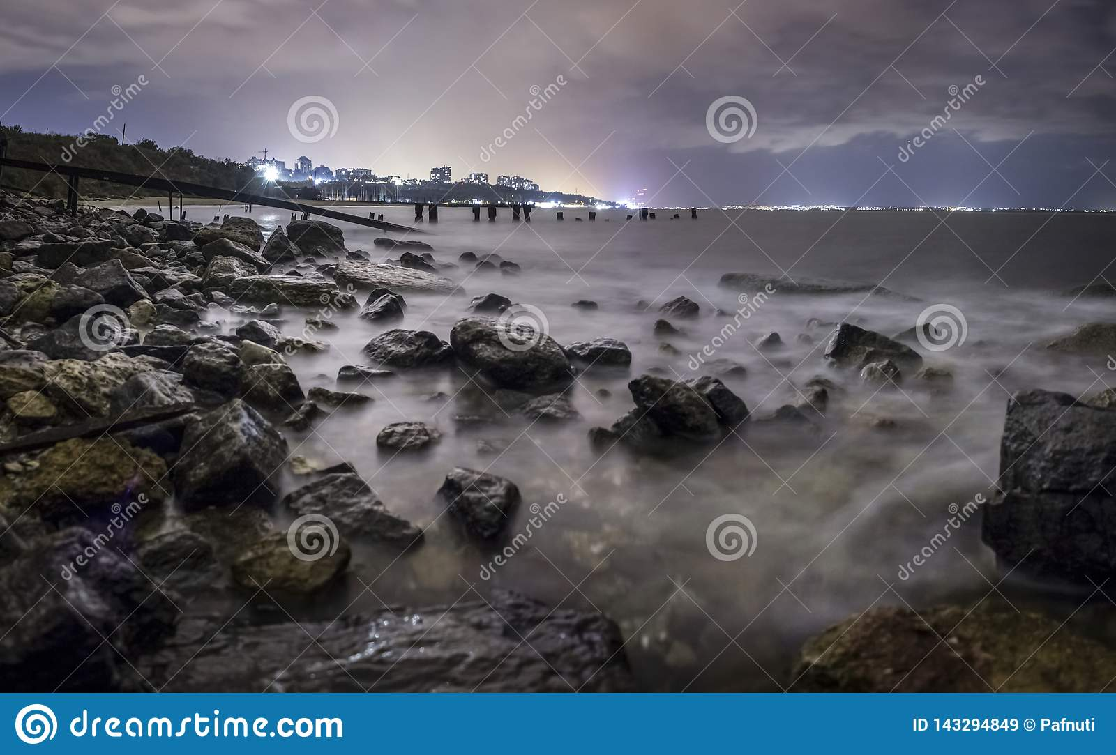 Long exposure of a stunning rocky beach in Odessa at dusk.
