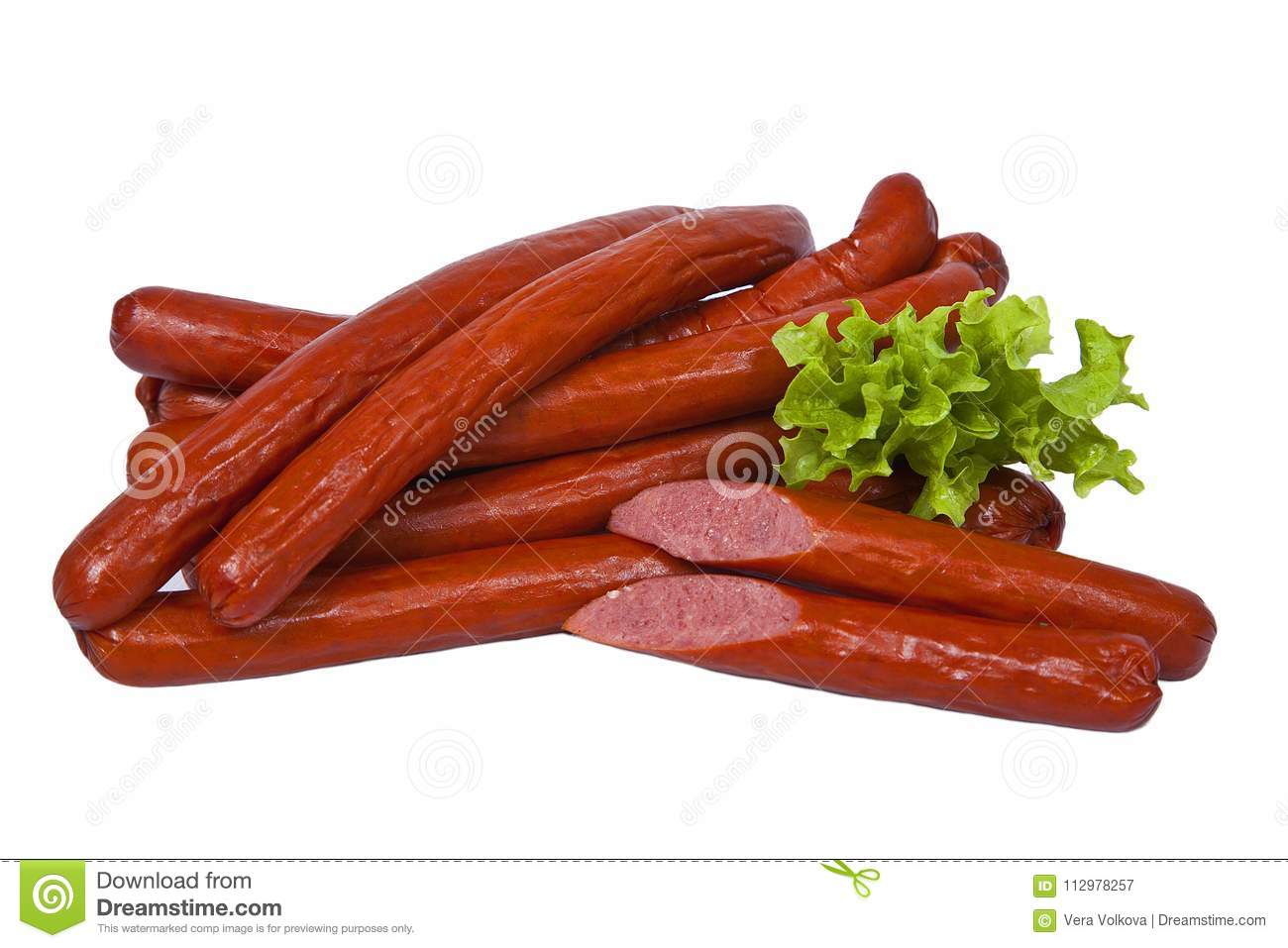 Long and fatty sausages with salad leaf. Isolated on white background