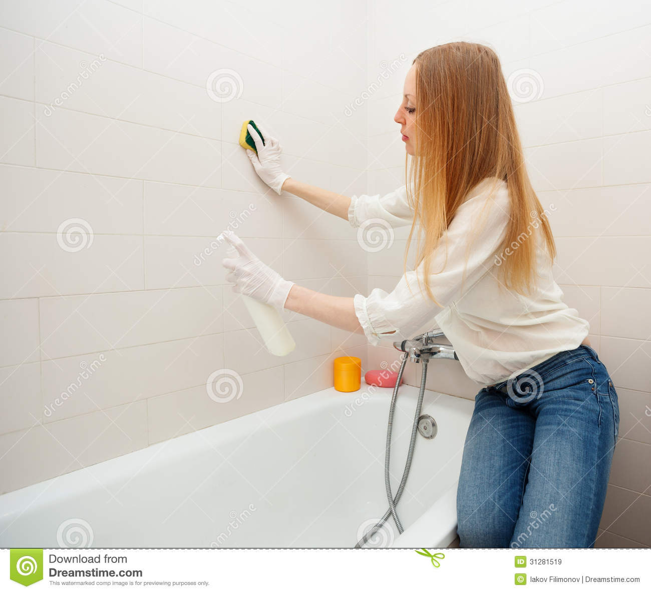 Long Haired Woman Cleaning Tile With Sponge In Bathroom