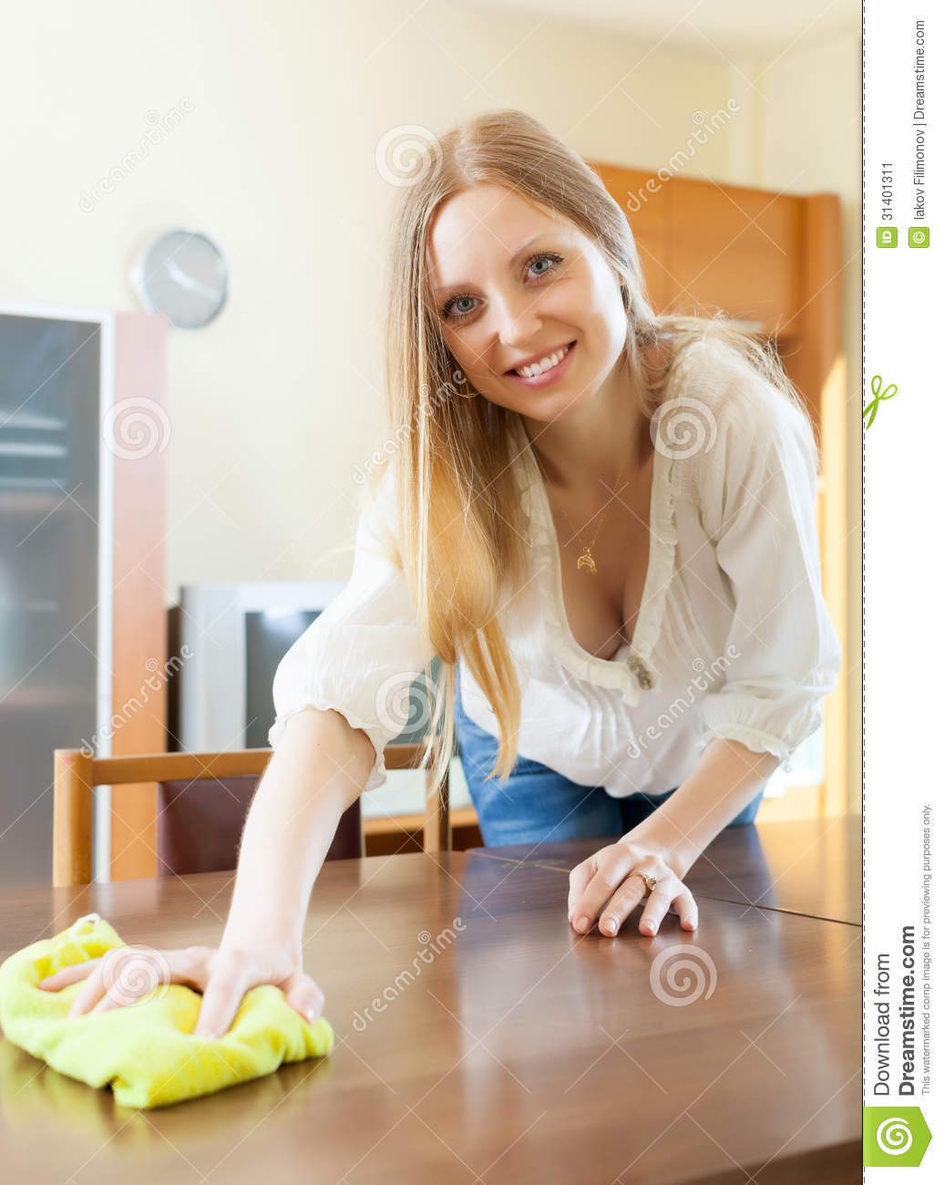 Long haired Woman Wiping The Dust From Table Stock Image