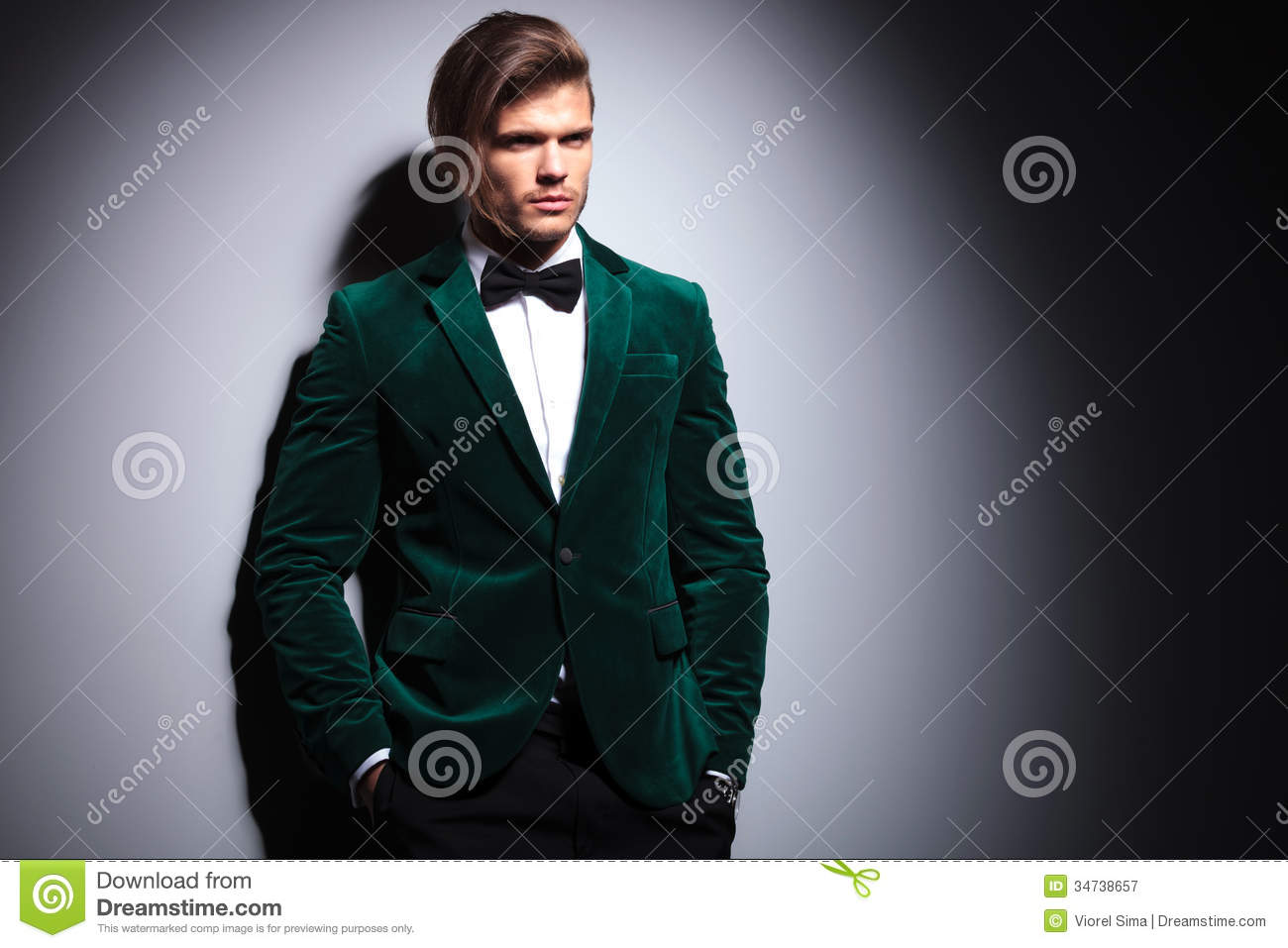 Long Haired Young Man In Velvet Suit And Bow Tie Royalty