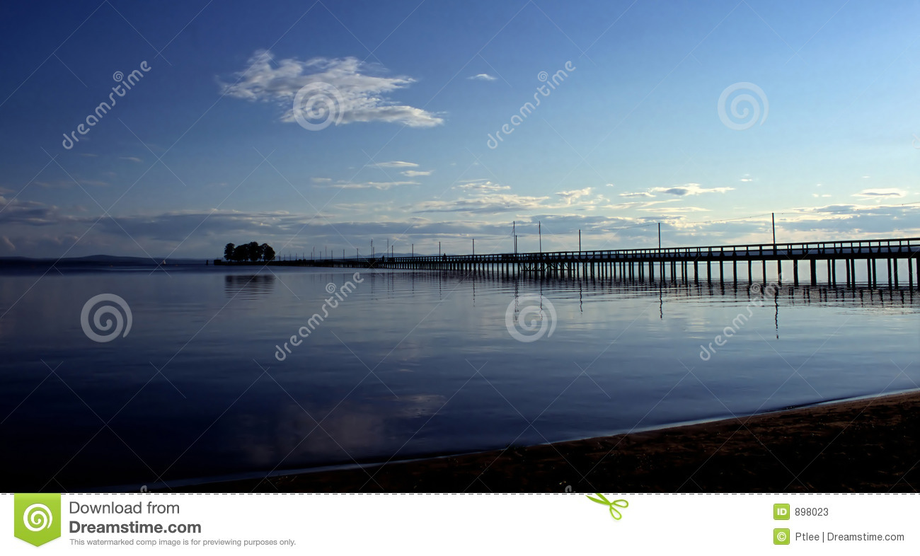 Long jetty in dusk and calm waters
