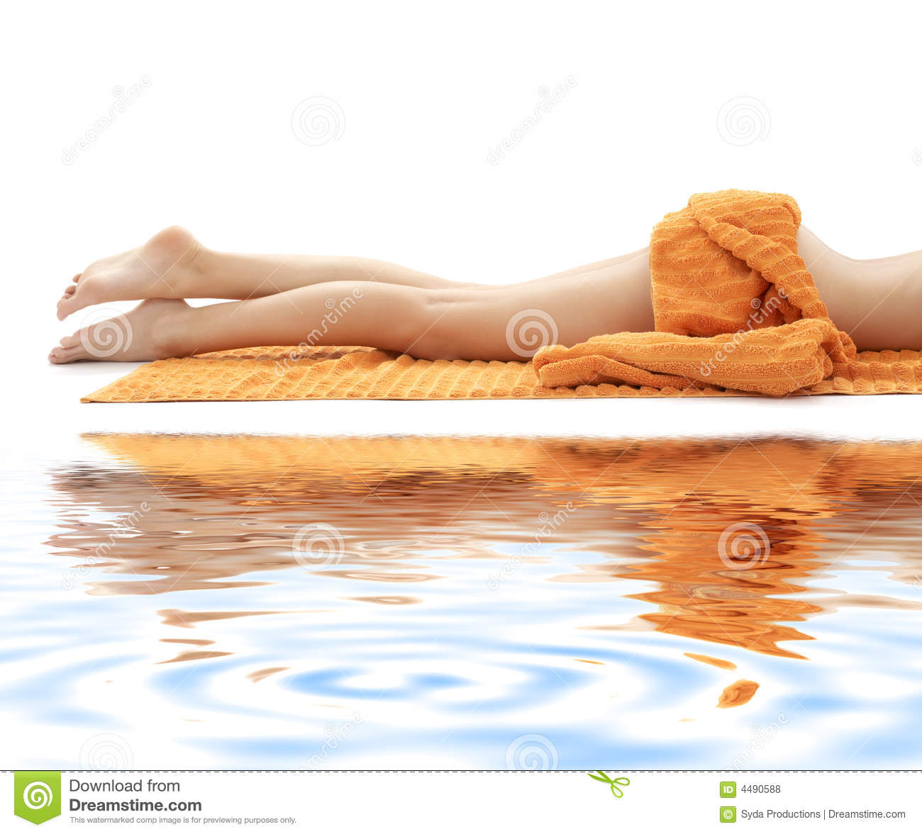 Long legs of relaxed lady with orange towel on whi