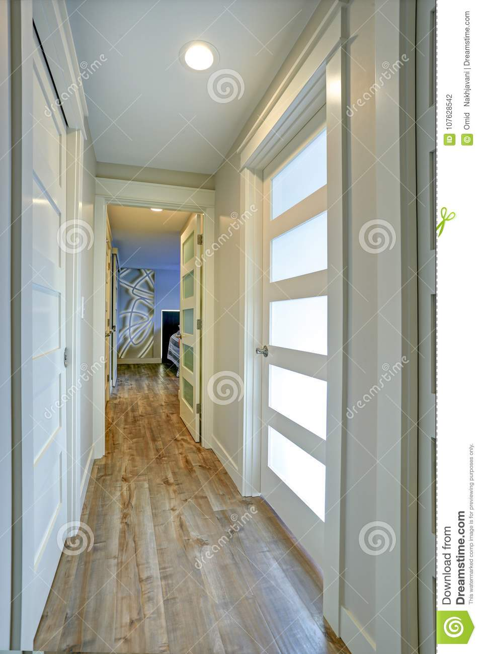 Narrow Foyer Xl : Long narrow corridor with white doors accented glass