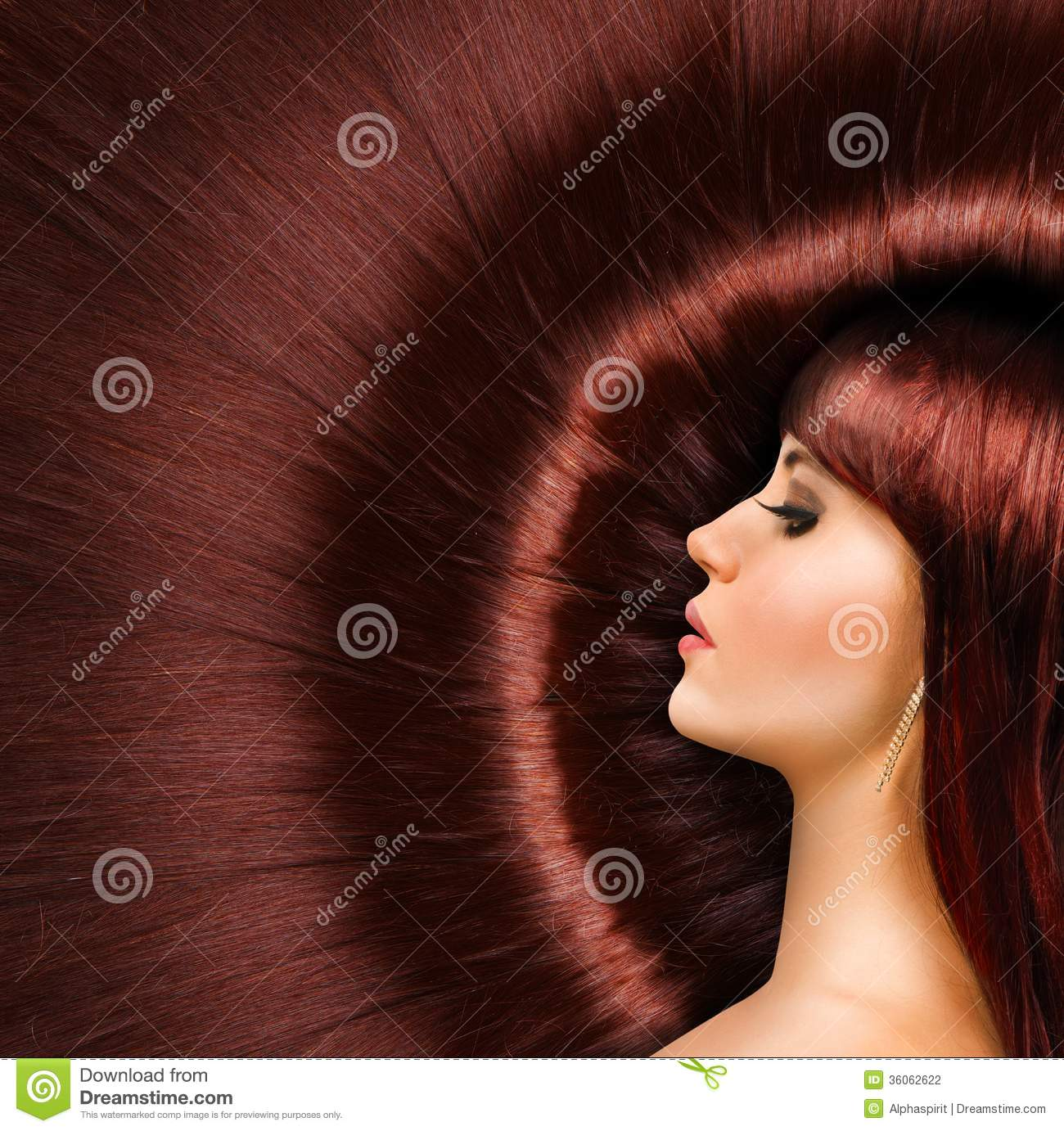 Long Red Shiny Hair Of A Beautiful Girl Stock Photo