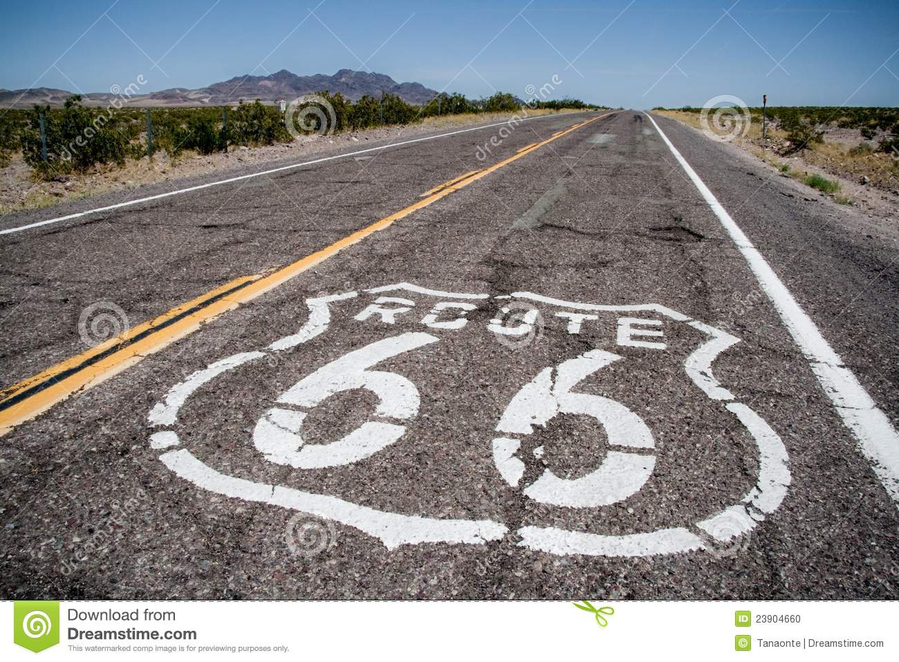 long road with a route 66 logo painted on it stock photo - image of