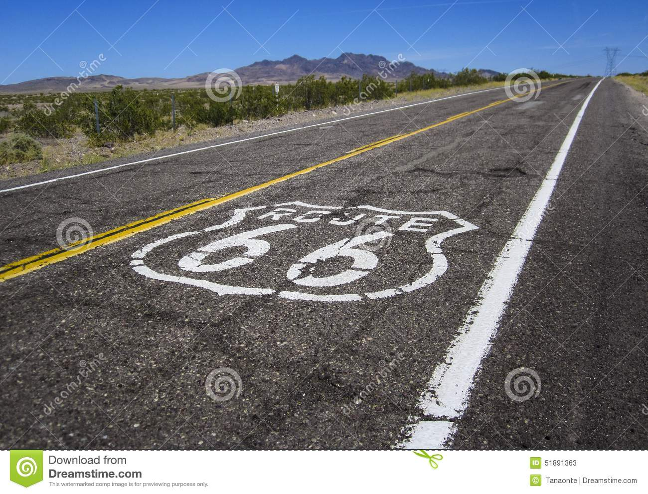 long road with a route 66 sign painted on it stock image - image of