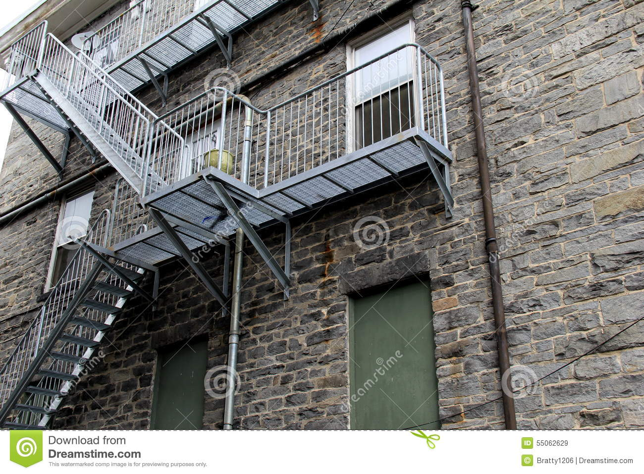 Long Set Of Metal Stairs On Outside Of Building