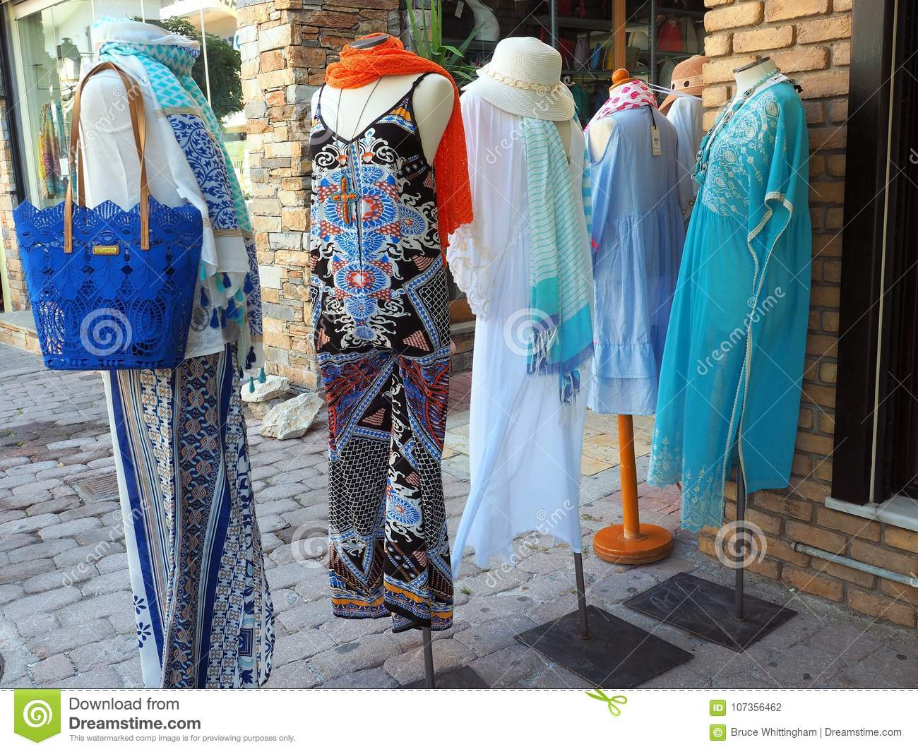 f22039161e57 Long summer womens beach gowns and pants suits on shop mannequins outside a tourist  shop on Skiathos