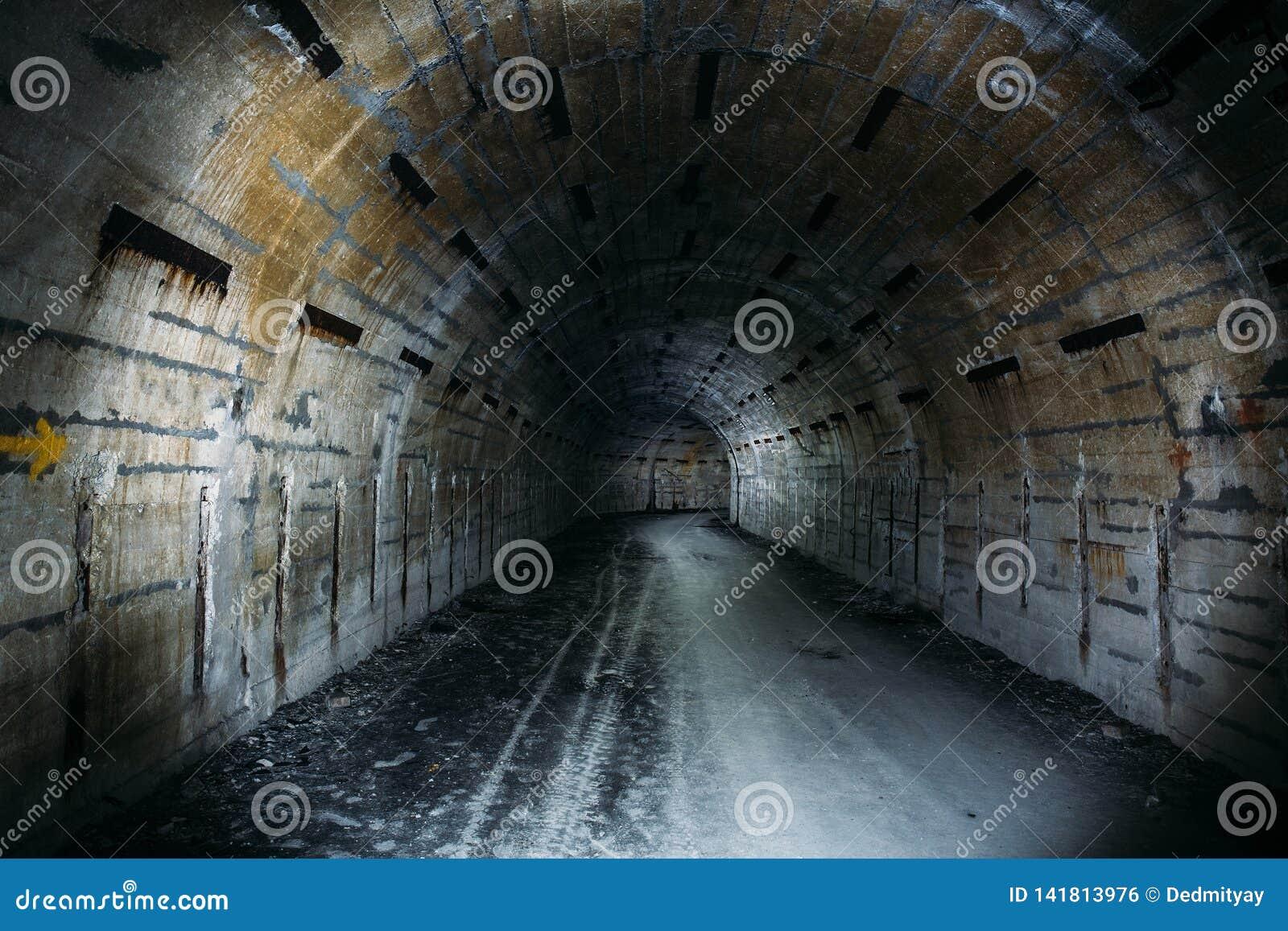 Long underground tunnel or corridor in abandoned Soviet military bunker