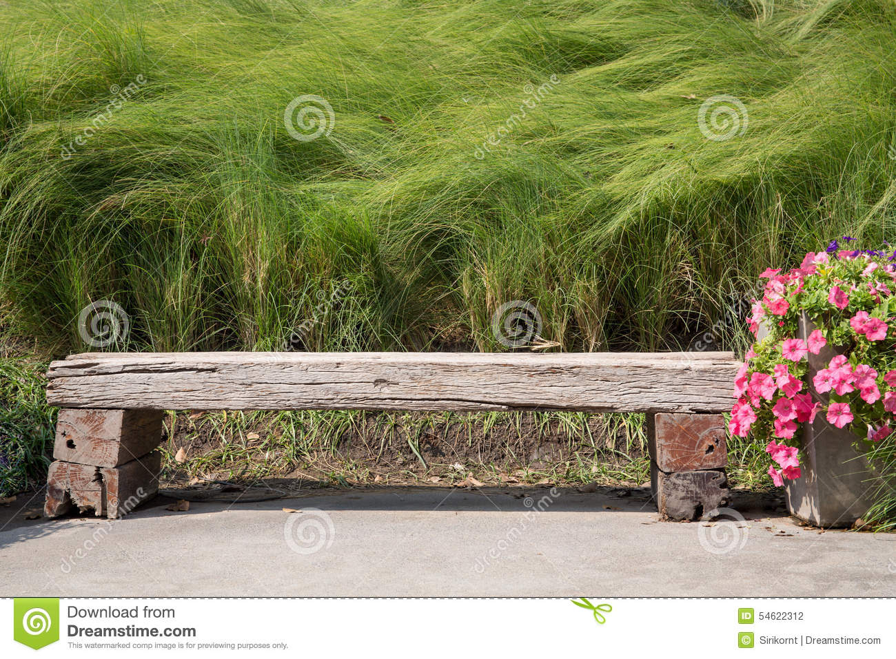 Long Wood Chair In A Garden Stock Photo - Image: 54622312