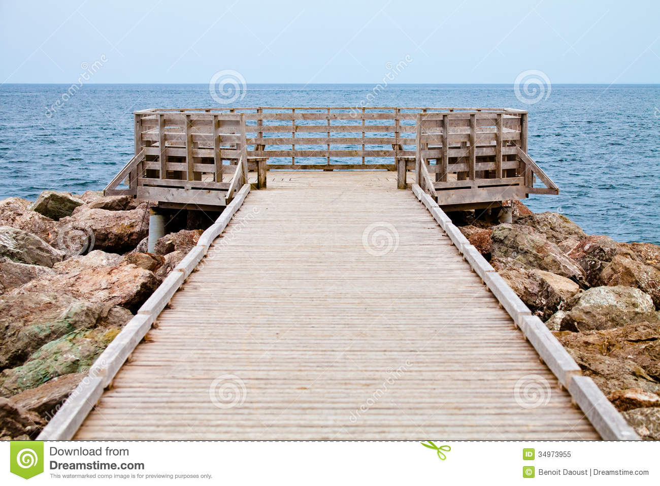 Long Wooden Dock With Observatory And View Of The Ocean