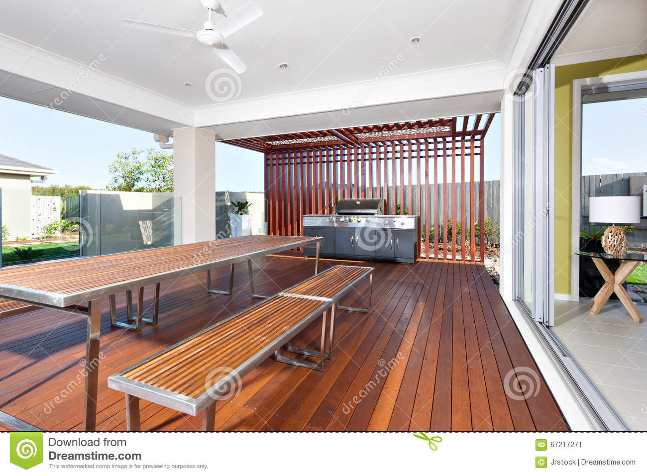 long wooden table and benches with modern grill cabinet in a lu . royaltyfree stock photo