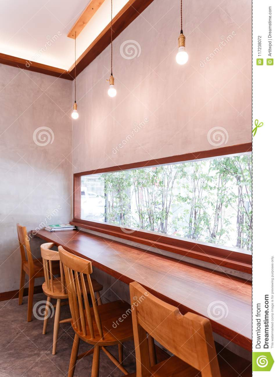 Picture of: Long Wooden Table With Wooden Chairs That Can See Outside Through The Glass Window At The Dessert Cafe Stock Photo Image Of Concept Home 117238072