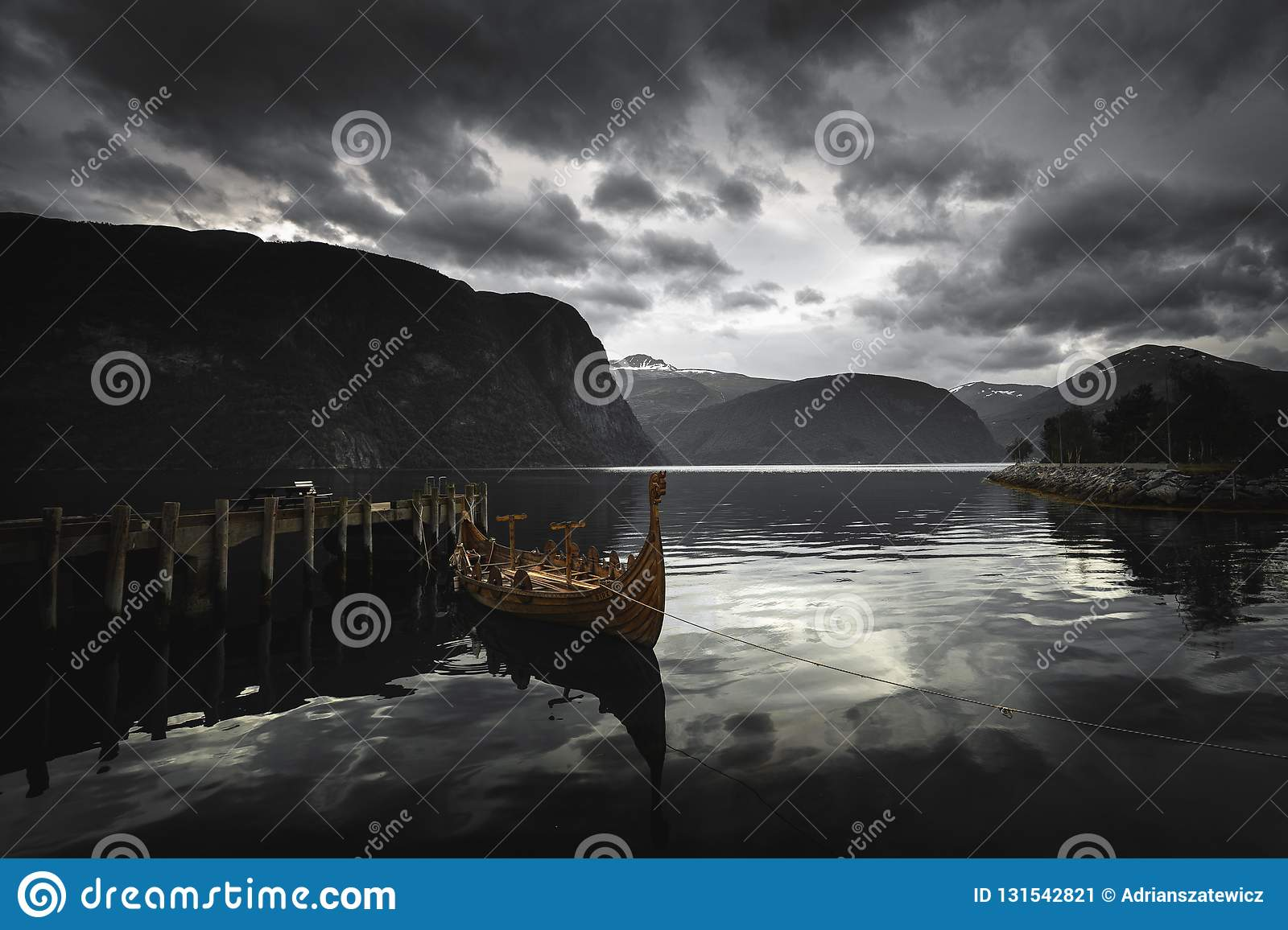 Longboat - viking`s wooden boat on Norddalsfjorden in middle Norway