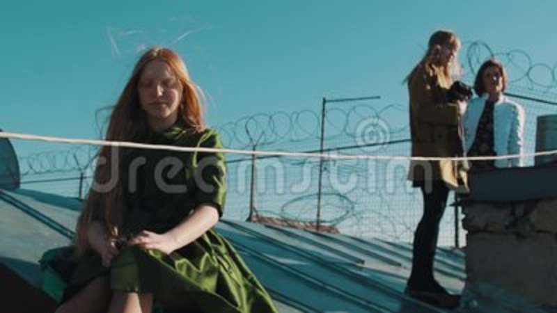 Longhaired Ginger Young Girl With Friends Sitting On Roofing With ...