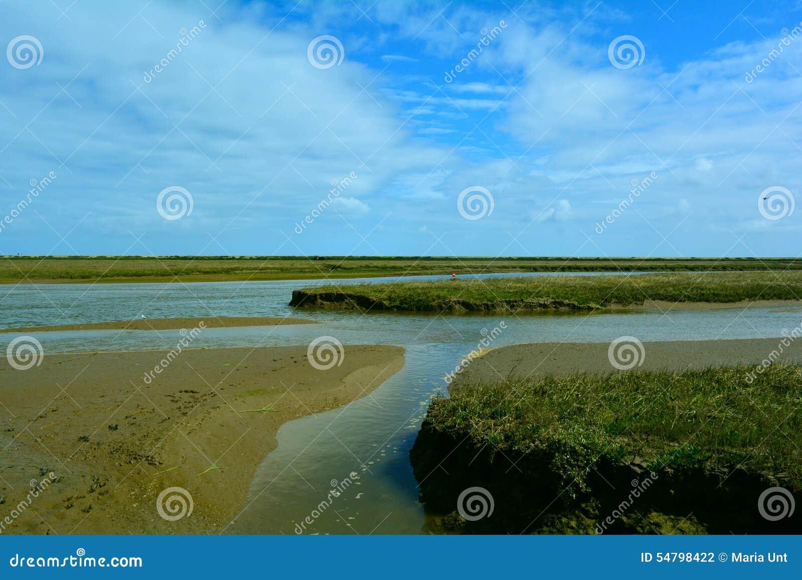Longs courant/rivière côtiers près de la plage, point de Blakeney, Norfolk, Royaume-Uni