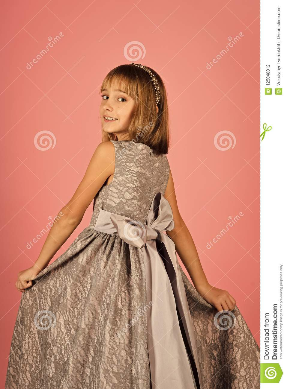 e8128de7e8aa Look, hairdresser, makeup. Child girl in stylish glamour dress, elegance. Little  girl in fashionable dress, prom. Fashion model on pink background, beauty.