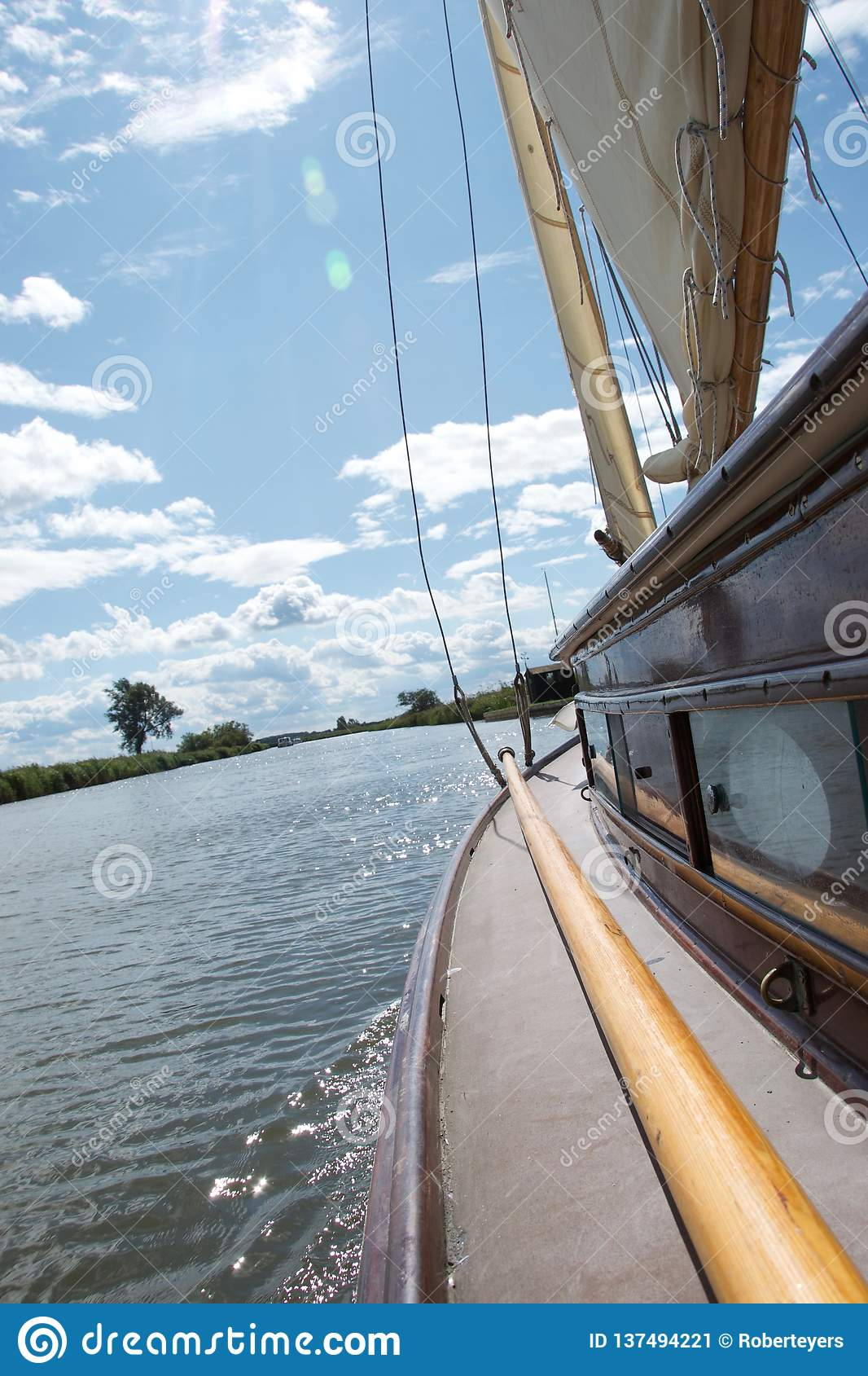 Side deck of a traditional yacht sailing on the Norfolk Broads