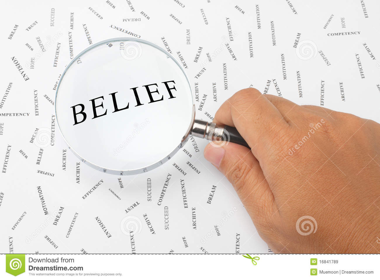 The word Belief is magnified