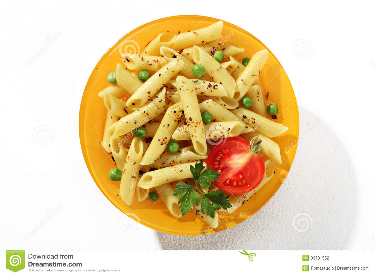 Looking Down At A Plate Of Cooked Tubular Pasta With Seasoning Herbs Stock Photo Image Of