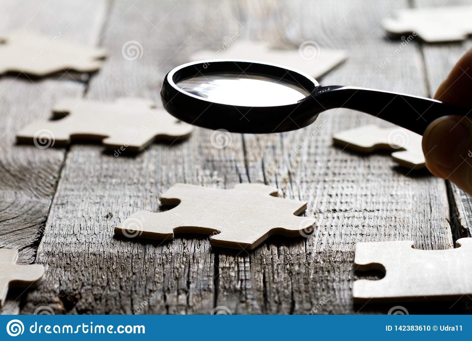 Looking for an employee partner in business concept with puzzle and magnifier