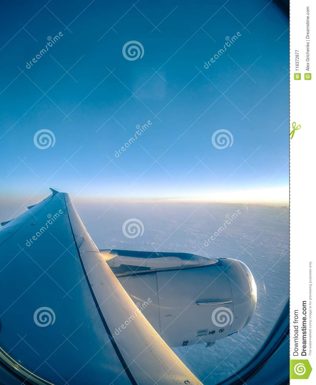 Looking Out Airplane Window And Flying Above The Clouds Stock Image